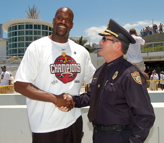 Miami Beach Chief of Police John Timoney congratulates Miami Heat center Shaquille O'Neal before the start of the team's NBA Championship Parade.