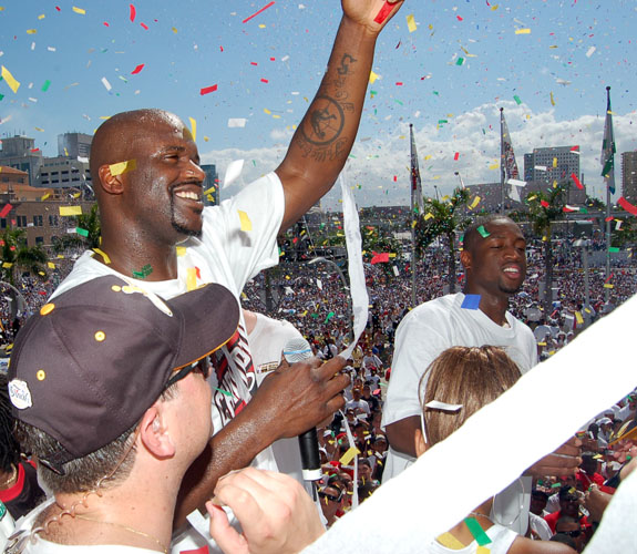 Miami Heat center Shaquille O'Neal acknowledges fans under a rain of confetti during the team's NBA Championship celebration at the Arena.