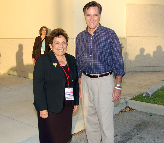 UM President Donna Shalala chats up ex-Massachusetts Governor Mitt Romney outside the Bank United Center before the GOP debate in Coral Gables, Fla.