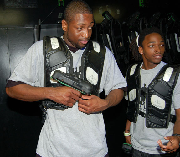 Miami Heat guard Dwyane Wade suits up for a game of laser tag during his Foundation's annual Christmas Party at Boomer's in Dania Beach, Fla.