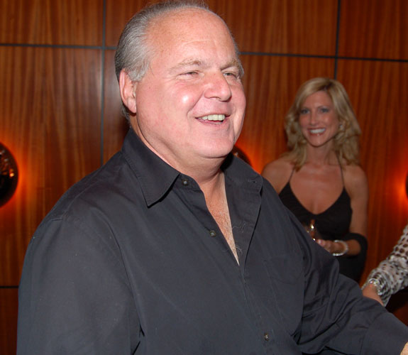 Conservative talk radio host Rush Limbaugh engages the local media on the red carpet at a Miami Beach fundraiser for his attorney Roy Black.