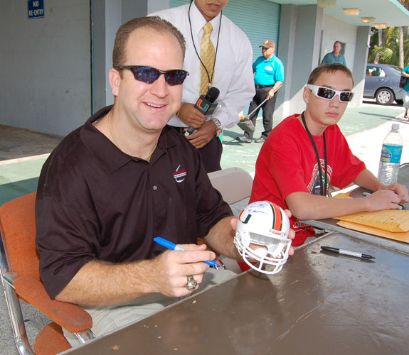Gino Torretta, who is best known for winning the Heisman Trophy in 1992, signs autographs for fans at the Orange Bowl closing ceremonies.